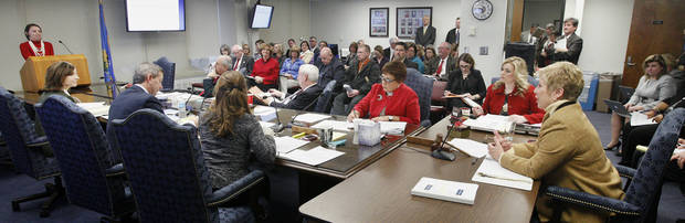 State schools Superintendent Janet Barresi, at right, asks a question of  Kerri White, assistant state superintendent, at left, during a state Board of Education meeting in Oklahoma City Wednesday, Dec. 19, 2012. Photo by Paul B. Southerland, The Oklahoman