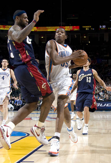 Oklahoma City's Kevin Durant (35) drives to the basket as Cleveland's LeBron James defends during the NBA game between the Oklahoma City Thunder and Cleveland Cavaliers, Sunday, Dec. 21, 2008, at the Ford Center in Oklahoma City. PHOTO BY SARAH PHIPPS, THE OKLAHOMAN