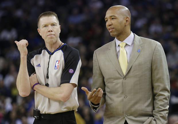New Orleans Hornets head coach Monty Williams, right, talks with referee Ed Malloy (14) during the second quarter of an NBA basketball game against the Golden State Warriors in Oakland, Calif., Wednesday, April 3, 2013. The Warriors won 98-88. (AP Photo/Jeff Chiu)