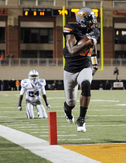 Oklahoma State's Justin Blackmon (81) scores a touchdown in the first quarter during a college football game between the Oklahoma State University Cowboys (OSU) and the Kansas State University Wildcats (KSU) at Boone Pickens Stadium in Stillwater, Okla., Saturday, Nov. 5, 2011.  Photo by Nate Billings, The Oklahoman