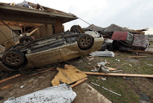 A truck and a car are among the debris near SW 149th and Western after a tornado struck south Oklahoma City and Moore, Okla., Monday, May 20, 2013. Photo by Nate Billings, The Oklahoman