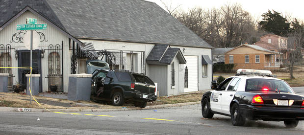 Oklahoma City police investigate a fatal wreck Tuesday at NE 18 and Martin Luther King Avenue. Police had responded to a reported assault to see a woman driving this vehicle, apparently fleeing the scene, and gave chase.  Photos by Paul B. Southerland, The Oklahoman