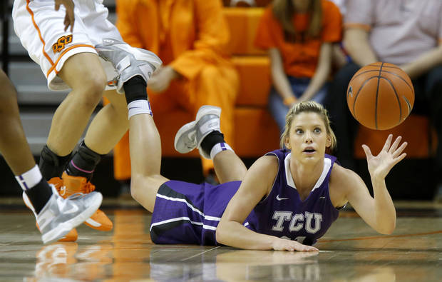 TCU's Kamy Cole (11) dives for the ball during a women's college basketball game between Oklahoma State University and TCU at Gallagher-Iba Arena in Stillwater, Okla., Tuesday, Feb. 5, 2013. Photo by Bryan Terry, The Oklahoman