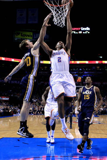 Oklahoma City's Thabo Sefolosha (2) dunks in front of Utah's Gordon Hayward (20)  during the NBA game between the Oklahoma City and the Utah Jazz and the Chesapeake Energy Arena, Friday,Nov. 30, 2012. Photo by Sarah Phipps, The Oklahoman