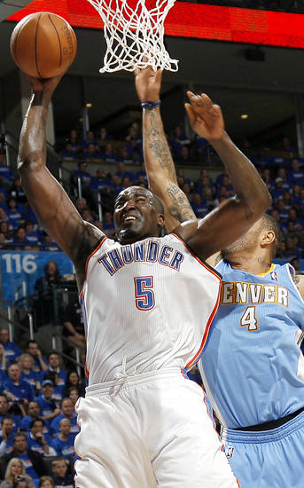 Oklahoma City&#039;s Kendrick Perkins Puts in a shot in front of Denver&#039;s  Kenyon Martin during the first round NBA Playoff basketball game between the Thunder and the Nuggets at OKC Arena in downtown Oklahoma City on Wednesday, April 20, 2011. The Thunder beat the Nuggets 106-89 and lead the series 2-0. Photo by John Clanton, The Oklahoman