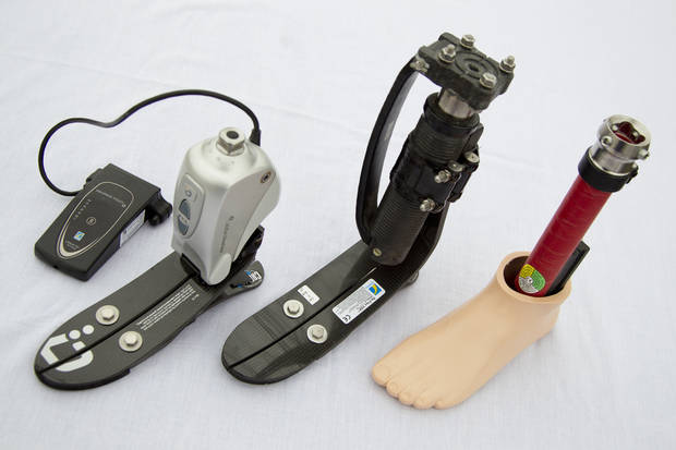 From left, a microprocessor-controlled ankle/foot prosthetic, a shock foot vertical loading pylon prosthetic and a flexible keel foot prosthetic are displayed at the Orthotic Prosthetic Center in Fairfax, Va. More than 200 people were injured in the Boston Marathon bombings and no one knows yet what the total medical costs will be. AP Photo