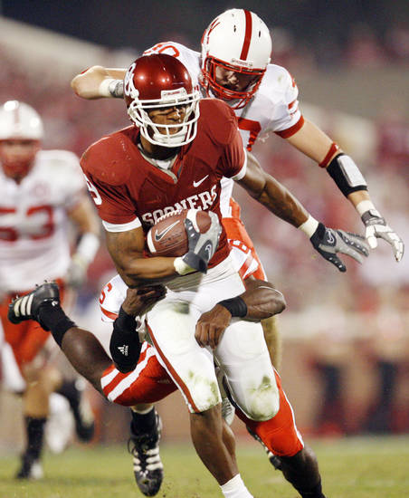 Nebraska's Blake Lawrence (40) and Armando Murillo (6) try to bring own OU's Juaquin Iglesias (9) during the second half of the college football game between the University of Oklahoma Sooners (OU) and the University of Nebraska Huskers (NU) at the Gaylord Family-Oklahoma Memorial Stadium, on Saturday, Nov. 1, 2008, in Norman, Okla. 