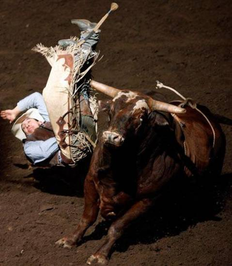Garrett Vig, from Newell, South Dakota, is bucked off a bull during the bull riding competition at the Okahoma State Fair Rodeo at the State Fair Arena in Oklahoma City, Friday, September 21, 2007. BY MATT STRASEN, THE OKLAHOMAN