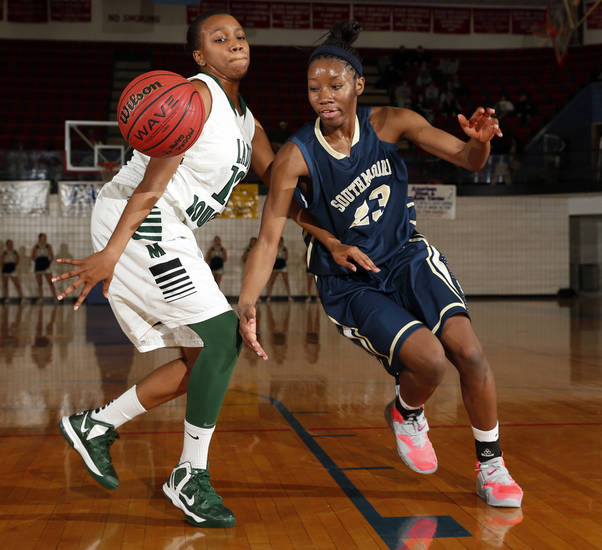 Southmoore&#039;s Serithia Hawkins, left,  and Muskogee&#039;s Sydni Carter go for a loose ball in the girls championship game of the John Nobles Invitational Tournament on Saturday, Jan. 26, 2013  in Moore, Okla. Photo by Steve Sisney, The Oklahoman