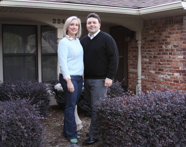 Alexis and Brian Lux are shown at their home on NW 43. They moved here from North Canton, Ohio, in 2008 and rented until they could buy a home last summer, all the while continue to own, and rent out, the house they left behind. Photo provided <strong> - PROVIDED</strong>