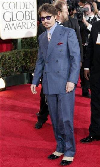"Johnny Depp, nominated for best actor in a drama for his work in ""Finding Neverland,"" arrives for the 62nd Annual Golden Globe Awards on Sunday, Jan. 16, 2005, in Beverly Hills, Calif.  (AP Photo/Mark J. Terrill)"