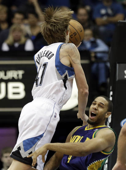 New Orleans Hornets' Xavier Henry, right, reacts as Minnesota Timberwolves' Andrei Kirilenko of Russia runs into him in the first quarter of an NBA basketball game Saturday, Feb. 2, 2013 in Minneapolis. Henry picked up a foul on the play. (AP Photo/Jim Mone)