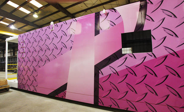The driller's cabin of this under-construction Nomac Drilling rig sports a pink ribbon design Thursday to support breast cancer awareness. <strong>PAUL B. SOUTHERLAND - The Oklahoman</strong>