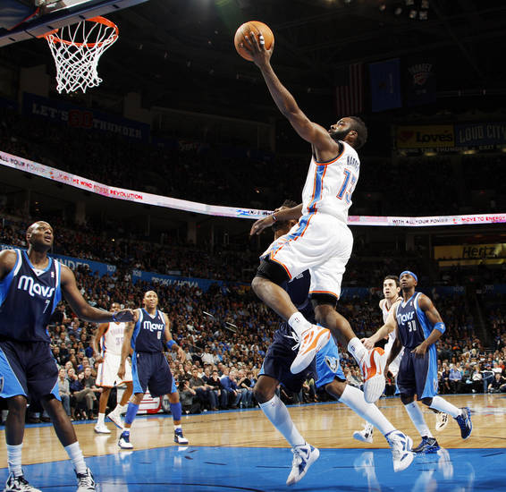 Oklahoma City's James Harden (13) takes a shot in the first half during an NBA basketball game between the Oklahoma City Thunder and the Dallas Mavericks at Chesapeake Energy Arena in Oklahoma City, Thursday, Dec. 29, 2011. Photo by Nate Billings, The Oklahoman