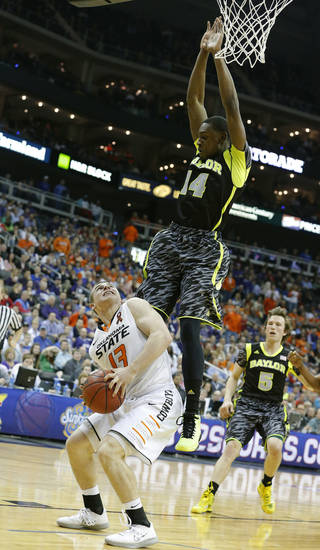 Oklahoma State's Phil Forte (13) waits to shoot as Baylor's Deuce Bello (14) defends during the Phillips 66 Big 12 Men's basketball championship tournament game between Oklahoma State University and Baylor at the Sprint Center in Kansas City, Thursday, March 14, 2013. Photo by Sarah Phipps, The Oklahoman