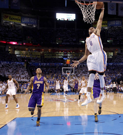 Oklahoma City's Russell Westbrook (0) dunks the ball during Game 2 in the second round of the NBA playoffs between the Oklahoma City Thunder and L.A. Lakers at Chesapeake Energy Arena in Oklahoma City, Wednesday, May 16, 2012.  Oklahoma City won 77-75. Photo by Bryan Terry, The Oklahoman