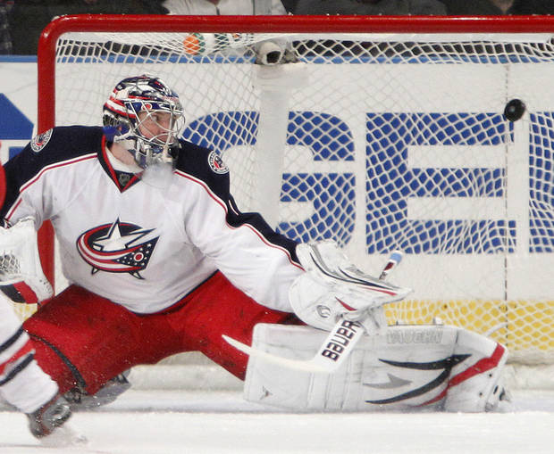 FILE -In this Feb. 19, 2012 file photo, Columbus Blue Jackets goalie Steve Mason allows a goal  during an NHL hockey game against the new York Rangers at Madison Square Garden in New York. There were times not so long ago when Mason and Sergei Bobrovsky were considered two of the brightest young goaltending stars in the entire NHL. Then both sank back into mediocrity. Now they're vying for playing time, and maybe a jump start to their careers, with the rebuilding Columbus Blue Jackets. (AP Photo/Kathy Willens, File)