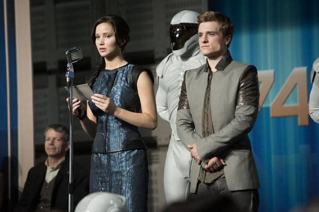 Jennifer Lawrence plays Katniss Everdeen and Josh Hutcherson plays Peeta Mellark in the sequel &quot;The Hunger Games: Catching Fire.&quot; Lionsgate photo &lt;strong&gt;&lt;/strong&gt;
