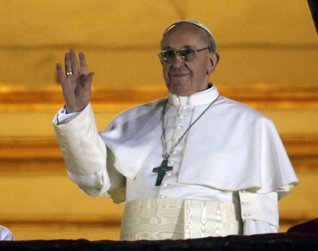 Pope Francis waves to the crowd from the central balcony of St. Peter's Basilica at the Vatican, Wednesday, March 13, 2013. Cardinal Jorge Bergoglio who chose the name of  Francis is the 266th pontiff of the Roman Catholic Church. (AP Photo/Gregorio Borgia) ORG XMIT: VAT131