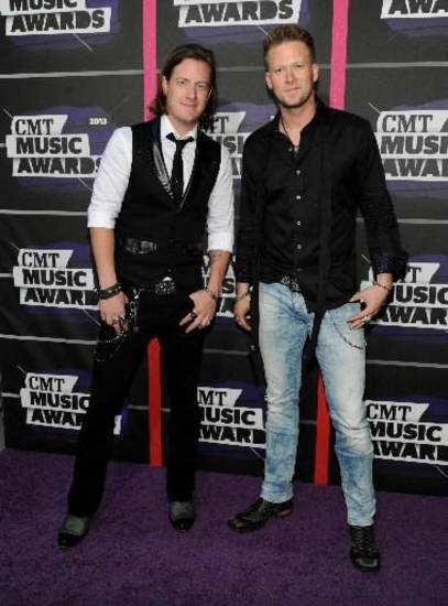Tyler Hubbard, left, and Brian Kelley, of the group Florida Georgia Line, arrive at the 2013 CMT Music Awards at Bridgestone Arena on Wednesday, June 5, 2013, in Nashville, Tenn.  (AP)