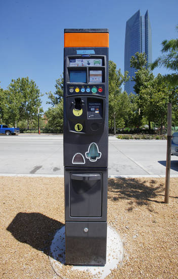 New electronic parking meters went live Monday in Oklahoma City. The meter prints receipts to be placed in parked cars. <strong>PAUL B. SOUTHERLAND - The Oklahoman</strong>