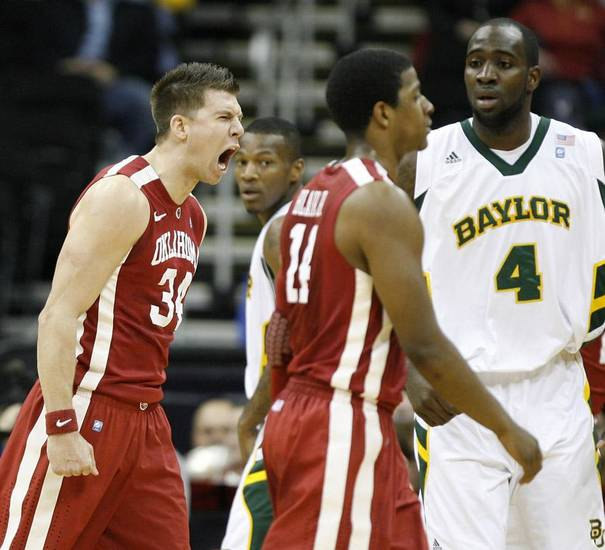 OU's Cade Davis reacts next to Baylor's Quincy Acy during the college basketball Big 12 Championship tournament game between the University of Oklahoma and Baylor in Kansas City, Mo., Wednesday, March 9, 2011.  Photo by Bryan Terry, The Oklahoman    ORG XMIT: OKC1103091441540726 KOD