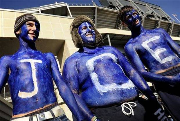 Decked in Penn State blue and white paint, freshmen Matt Thompson, Killian Kidd and Chris Farion show their support for former Penn State head coach Joe Paterno while being interviewed outside Beaver Stadium on Saturday, November 12, 2011. (AP Photo/Lincoln Journal Star, FRANCIS GARDLER)