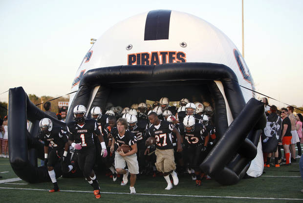 Putnam City runs on to the field before a high school football game between Putnam City and Del City in Oklahoma City, Thursday, Sept. 29, 2011. Photo by Sarah Phipps, The Oklahoman