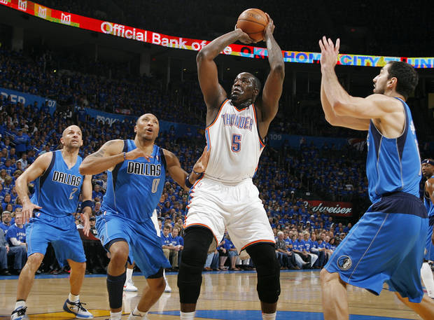 Oklahoma City&#039;s Kendrick Perkins (5) takes a shot near Jason Kidd (2), Shawn Marion (0) and Peja Stojakovic (16) of Dallas during game 4 of the Western Conference Finals in the NBA basketball playoffs between the Dallas Mavericks and the Oklahoma City Thunder at the Oklahoma City Arena in downtown Oklahoma City, Monday, May 23, 2011. Photo by Nate Billings, The Oklahoman ORG XMIT: KOD