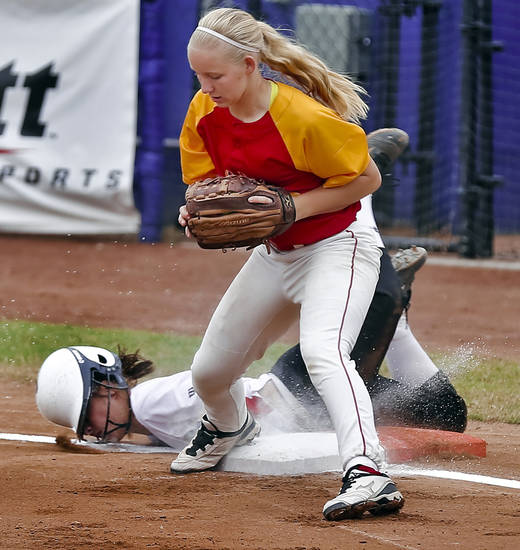 HIGH SCHOOL SOFTBALL TOURNAMENT: Wayne's Casey Redus (9) goes face first in the ground as Dale's Jaelin Flewallen (13) gets the out at first during the Oklahoma State Softball tournament game between Wayne and Dale at ASA Hall of Fame Stadium on Thursday, Oct. 4, 2012, in Oklahoma City, Okla.   Photo by Chris Landsberger, The Oklahoman