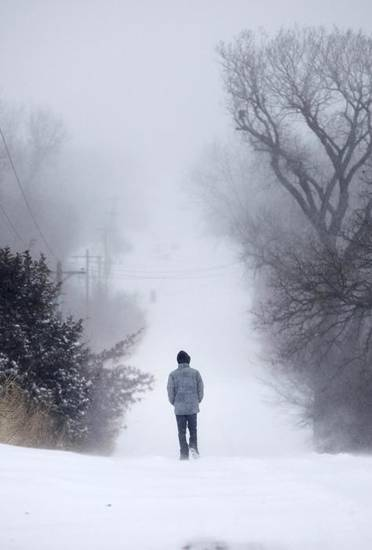 SNOW / BLIZZARD / WINTER STORM / COLD WEATHER: A man walks through deep snow on E Charter Oak Road in Logan County, Oklahoma February  2 , 2011. Photo by Steve Gooch, The Oklahoman ORG XMIT: KOD