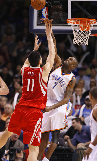 Joe Smith blocks a shot by Yao Ming in the first half as the Oklahoma City Thunder plays the Houston Rockets at the Ford Center in Oklahoma City, Okla. on Friday, January 9, 2009. 