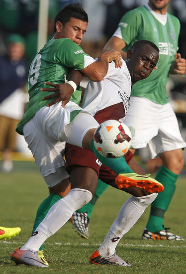 Mickey Lopez of the Oklahoma City Energy FC fights for the ball against Sacramento FC's Sacramento FC's Mawolo Gissie  during a soccer game in Oklahoma City, Saturday, June 28, 2014. Photo by Bryan Terry, The Oklahoman