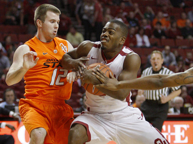 Oklahoma's Sam Grooms (1) goes past Oklahoma State's Keiton Page (12) during the Bedlam men's college basketball game between the University of Oklahoma Sooners and the Oklahoma State Cowboys in Norman, Okla., Wednesday, Feb. 22, 2012. Photo by Bryan Terry, The Oklahoman