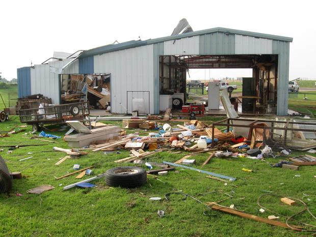 People salvage what they can after a storm tore threw the Piedmont area Tuesday, May 24, 2011. Photo by Matt Dinger, The Oklahoman