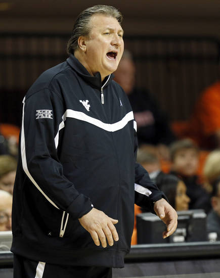 West Virginia head coach Bob Huggins gives instructions to his players during an NCAA men's basketball game between Oklahoma State University (OSU) and West Virginia at Gallagher-Iba Arena in Stillwater, Okla., Saturday, Jan. 26, 2013. Photo by Nate Billings, The Oklahoman