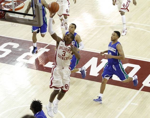 OU: Oklahoma's Buddy Hield (3) shoots during a college basketball game between the University of Oklahoma and Texas A&M Corpus Christi at McCasland Field House in Norman, Okla., Monday, Dec. 31, 2012.  Photo by Garett Fisbeck, For The Oklahoman