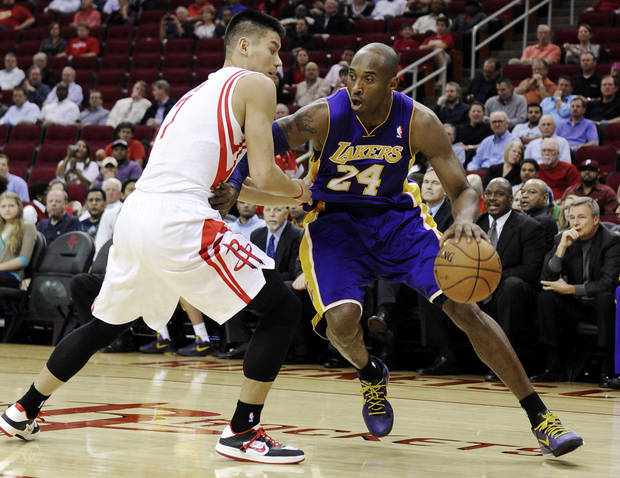 Los Angeles Lakers' Kobe Bryant (24) pushes against Houston Rockets' Jeremy Lin, left, in the first half of an NBA basketball game, Tuesday, Dec. 4, 2012, in Houston. (AP Photo/Pat Sullivan)