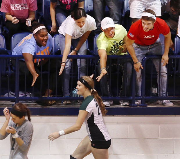 Enthusiastic fans encourage Santa Fe players as they change ends of the court after a match in first round action during Stillwater vs. Edmond Santa Fe game in Class 6A volleyball tournament at Shawnee High School on Friday, Oct. 12, 2012.   Photo by Jim Beckel, The Oklahoman