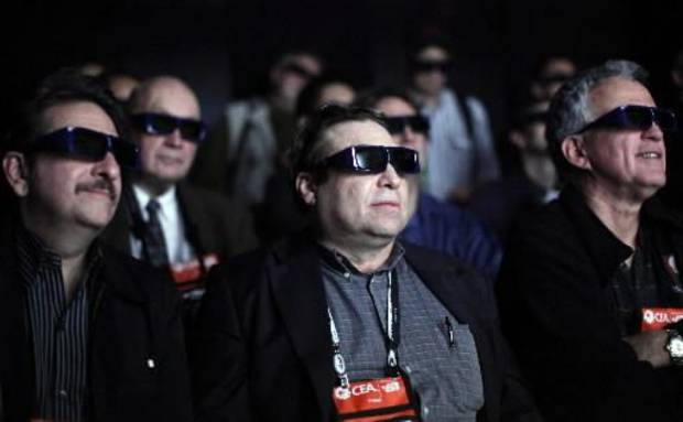 In this Jan. 7, 2009 file photo, members of the media wear 3D glasses as they watch movie clips at the Panasonic 3D full HD plasma theater at the International Consumer Electronics Show (CES) in Las Vegas, USA. (AP)