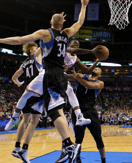 Oklahoma City's Reggie Jackson (15) goes to the basket between Minnesota's Andrei Kirilenko (47), Greg Stiemsma (34), and Derrick Williams (7) during an NBA basketball game between the Oklahoma City Thunder and the Minnesota Timberwolves at Chesapeake Energy Arena in Oklahoma City, Wednesday, Jan. 9, 2013.  Oklahoma City won 106-84. Photo by Bryan Terry, The Oklahoman
