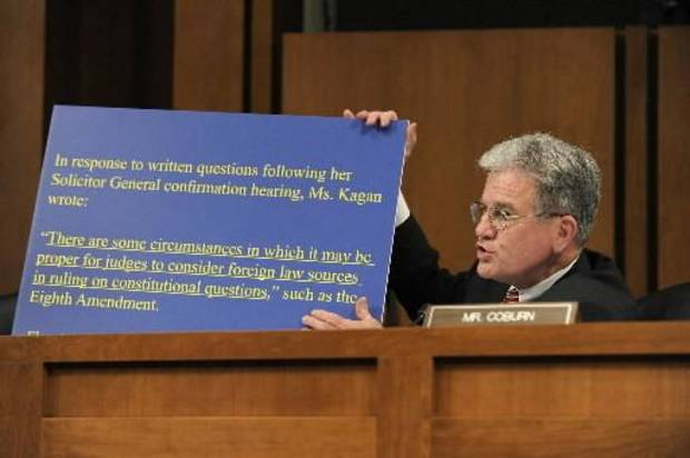 Senate Judiciary Committee member Sen. Tom Coburn, R-Okla., holds up a sign with a quote from Supreme Court nominee Elena Kagan during her confirmation hearing before the committee, Tuesday, June 29, 2010, on Capitol Hill in Washington. (AP Photo/Susan Walsh)