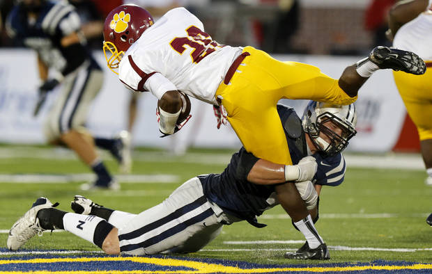 Putnam City North's Larry Butler is brought down by Edmond North's Brock Byford during a high school football game at Wantland Stadium in Edmond, Okla., Friday, September 21, 2012. Photo by Bryan Terry, The Oklahoman