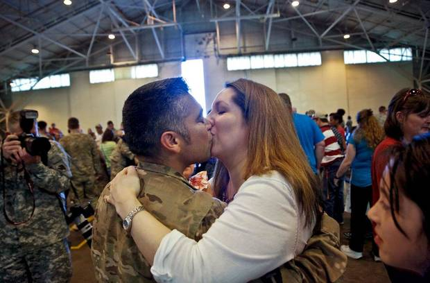 Staff Sgt. Orlando Ornelas kisses his wife Camille during the return ceremony for the National Guard's 45th Infantry Brigade Combat Team troops at the National Guard Base on Thursday, March 15, 2012, in Oklahoma City, Oklahoma.  Photo by Chris Landsberger, The Oklahoman
