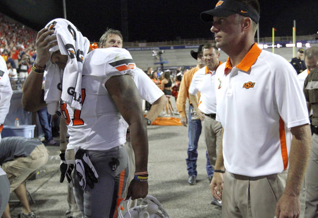 Oklahoma State's Tracy Moore (87) walks off the field with Oklahoma State head coach Mike Gundy following the college football game between the University  of Arizona and Oklahoma State University at Arizona Stadium in Tucson, Ariz.,  Sunday, Sept. 9, 2012. Photo by Sarah Phipps, The Oklahoman
