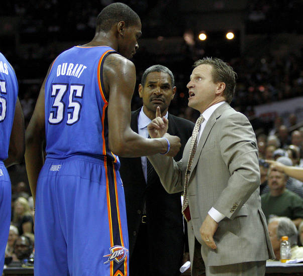Oklahoma City's Kevin Durant (35) talks with coach Scot Brooks as assistant Maurice Cheeks watches after a technical foul during Game 2 of the Western Conference Finals between the Oklahoma City Thunder and the San Antonio Spurs in the NBA playoffs at the AT&T Center in San Antonio, Texas, Tuesday, May 29, 2012. Oklahoma City lost 120-111. Photo by Bryan Terry, The Oklahoman