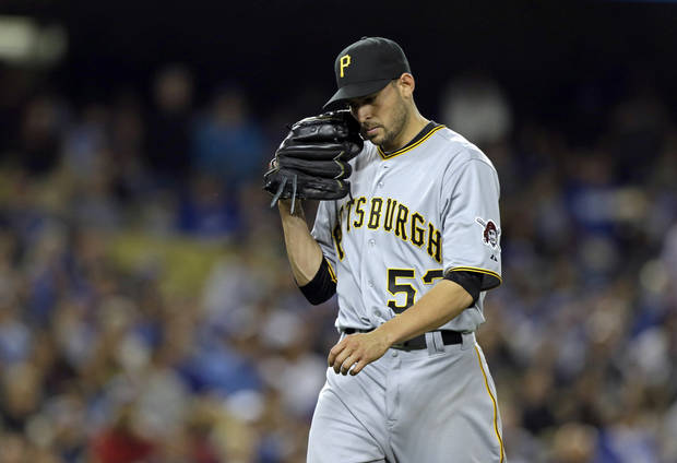 Pittsburgh Pirates starting pitcher Jonathan Sanchez comes out of the game against the Los Angeles Dodgers in the sixth inning of a baseball game in Los Angeles Friday, April 5, 2013. (AP Photo/Reed Saxon)