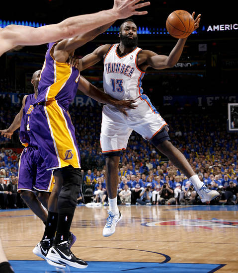 Oklahoma City's James Harden (13) passes the ball from beside Los Angeles' Andrew Bynum (17) during Game 5 in the second round of the NBA playoffs between the Oklahoma City Thunder and the L.A. Lakers at Chesapeake Energy Arena in Oklahoma City, Monday, May 21, 2012. Oklahoma City won 106-90.  Photo by Bryan Terry, The Oklahoman