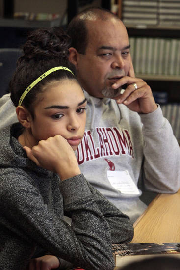 Western Heights Middle School eighth grade student Alexsa Esparza and her father John Paul Esparza listen during a reading class as her school kicks off its first day of training for its One Kid Challenge program on Saturday, Dec. 15, 2012, in Oklahoma City, Okla.  Photo by Steve Sisney, The Oklahoman