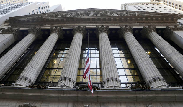 A flag flies on the facade of the New York Stock Exchange Thursday, Dec. 20, 2012. Shares in the company that runs the New York Stock Exchange are surging amid reports that it is in talks to sell itself to a rival stock exchange, Atlanta-based IntercontinentalExchange Inc. (AP Photo/Richard Drew)